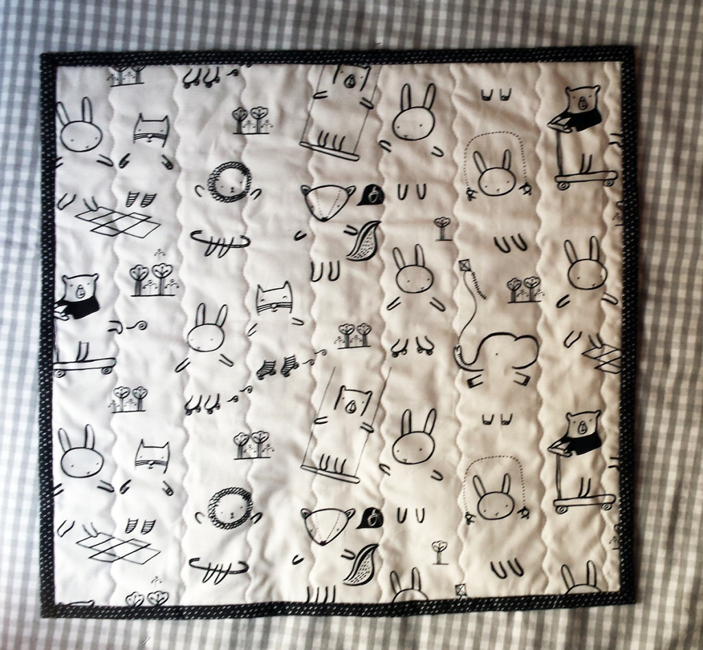Quilted kids dress up doll play mat with Wee Gallery fabric.