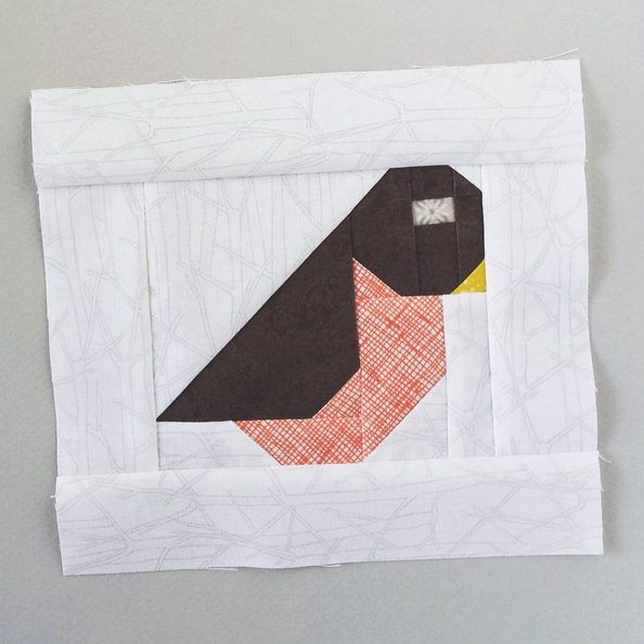 Bird quilt block design by Sew Fresh Quilts. Pattern is part of a pattern for a quilted table runner.
