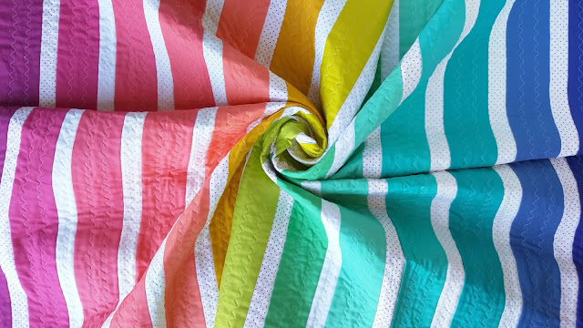 Rainbow Stripe Baby Quilt by Allison Jensen